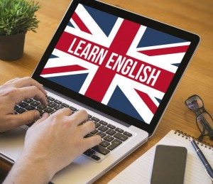 learn english concept. Close-up top view of english learning on laptop. all screen graphics are made up.
